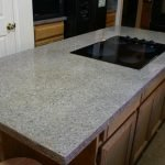 Black-and-white-synthetic-granite-counter-with-cooktop
